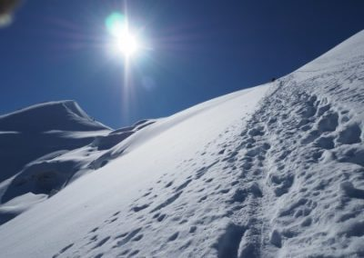 Steep snow and the ridge leading to the summit